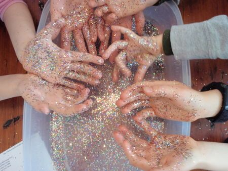 A lesson in handwashing. The Hand Washing Lesson. i want to try this next yr. The lesson uses lotion-covered hands and glitter to illustrate how germs spread. I placed glitter on one student's hand and had the student shake hands, high five, and share a pencil with other students, and watching their reactions when they then had glitter (germs) on their hands was great! They then took turns washing their hands, learning just how much effort you should always