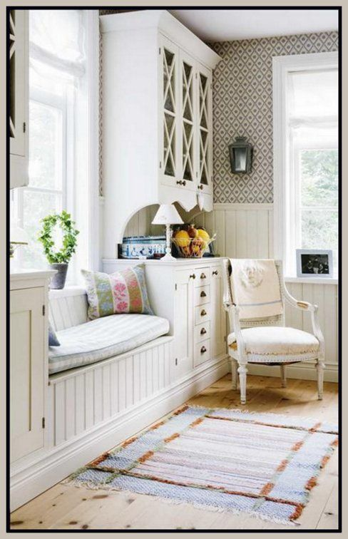 Window Seat Flanked by Two Great Cupboards