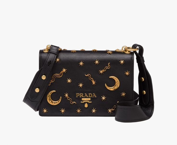 Calf leather shoulder bag embellished with star and moon appliqués Leather…