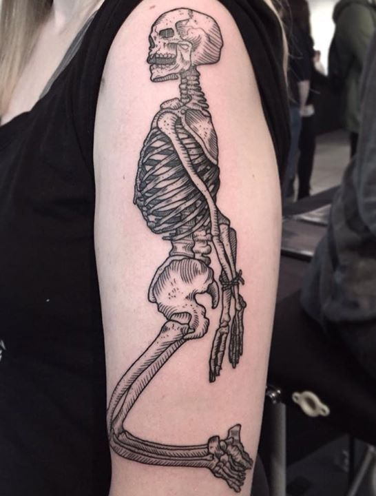 Black skeleton arm tattoo by Dennis from Green Pearl Tattoo
