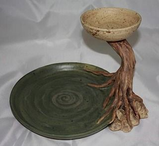 serving plate with dip bowl - I've seen so many of these and am not usually impressed with them, but this one is really interesting and well designed.