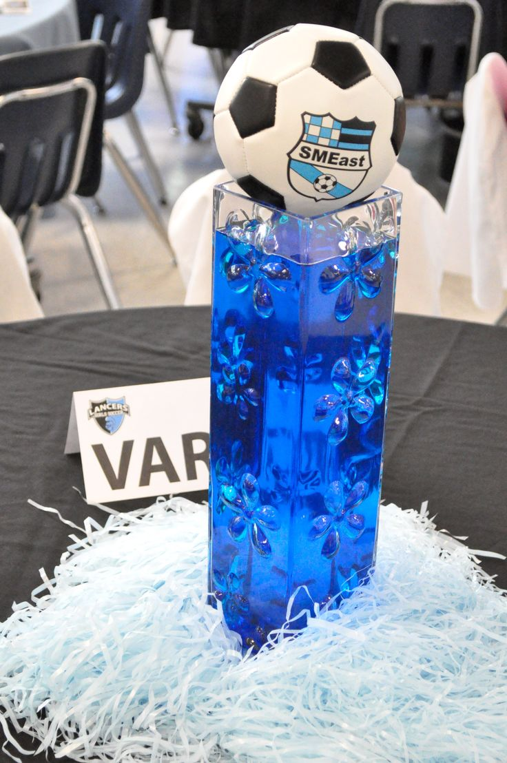 Our soccer banquet centerpieces.  We colored the water blue to match our school colors.  I ordered the soccer balls to go on top.