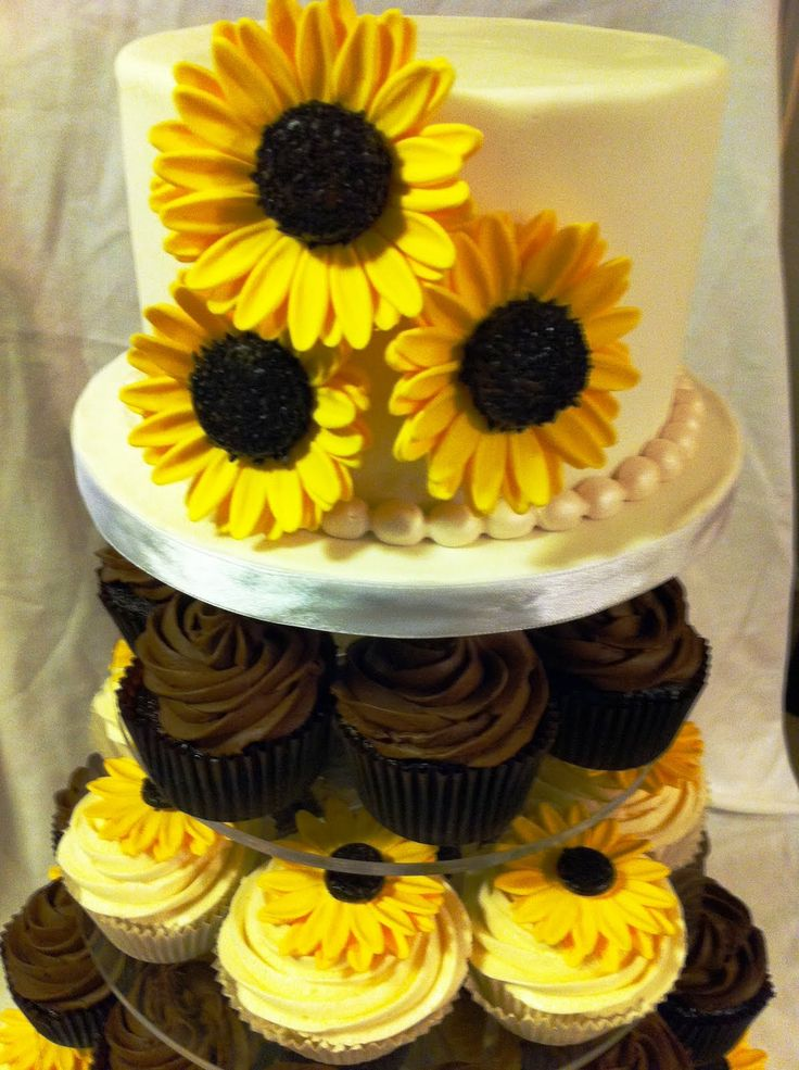 wedding cakes made with sunflower cup cakes | The brown layer on the cupcake tower included chocolate cupcakes ...
