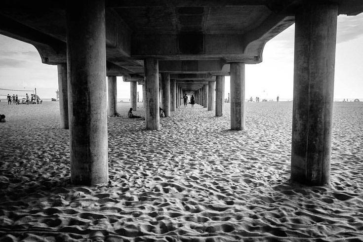 Under the pier at huntington beach mattlarastreet leica