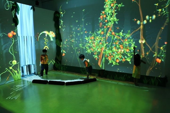 "There are a million reasons to celebrate the awesomeness of ""Funky Forest"" by Design I/O.  The projections completely transform the bare room, adorning otherwise blank walls with vines …"
