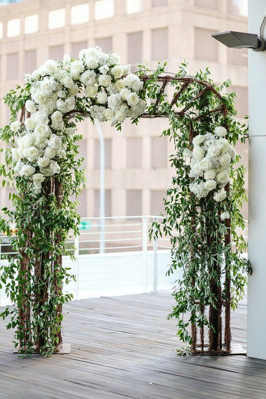 Greenery wedding ceremony decor - ceremony arch with greenery and white hydrangeas {Pearl Events Austin}
