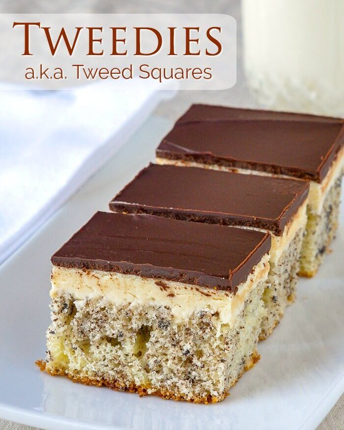 """Tweed Squares a.k.a. """"Tweedies"""" – vanilla cake with flecks of grated chocolate baked in, topped with vanilla frosting and finished with a layer of chocolate. A Newfoundland favourite."""
