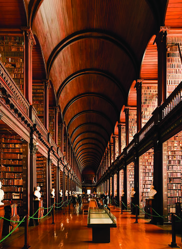 """<p>Trinity College Dublin's library was built in 1592, and houses the 1,000-year-old Book of Kells. Controversy was sparked when librarians realized the long room, pictured here, bears striking resemblance to the Jedi Archives in the Jedi Temple in <em><a href=""""http://en.wikipedia.org/wiki/Trinity_College_Library#In_popular_culture"""" target=""""_blank"""">Star Wars</a></em>--but director George Lucas called it a coincidence.</p>"""