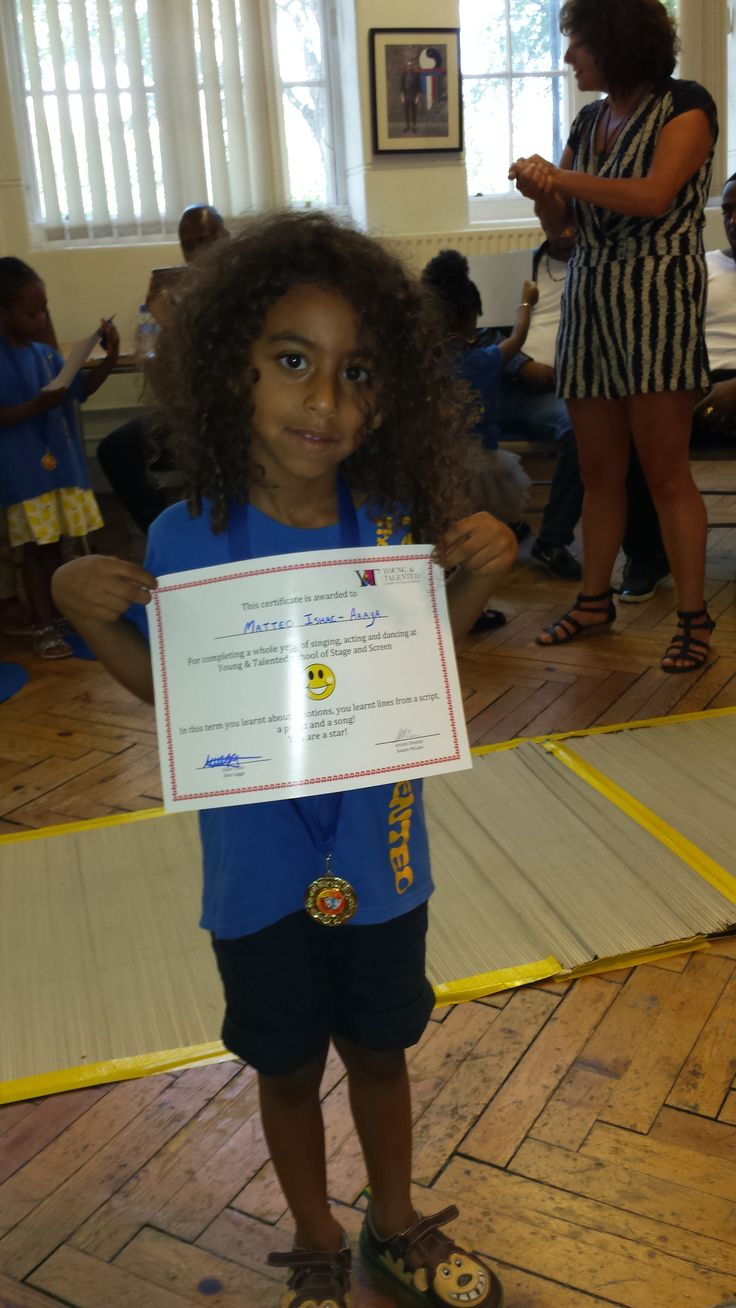 Y&T Tots Student with Certificate!