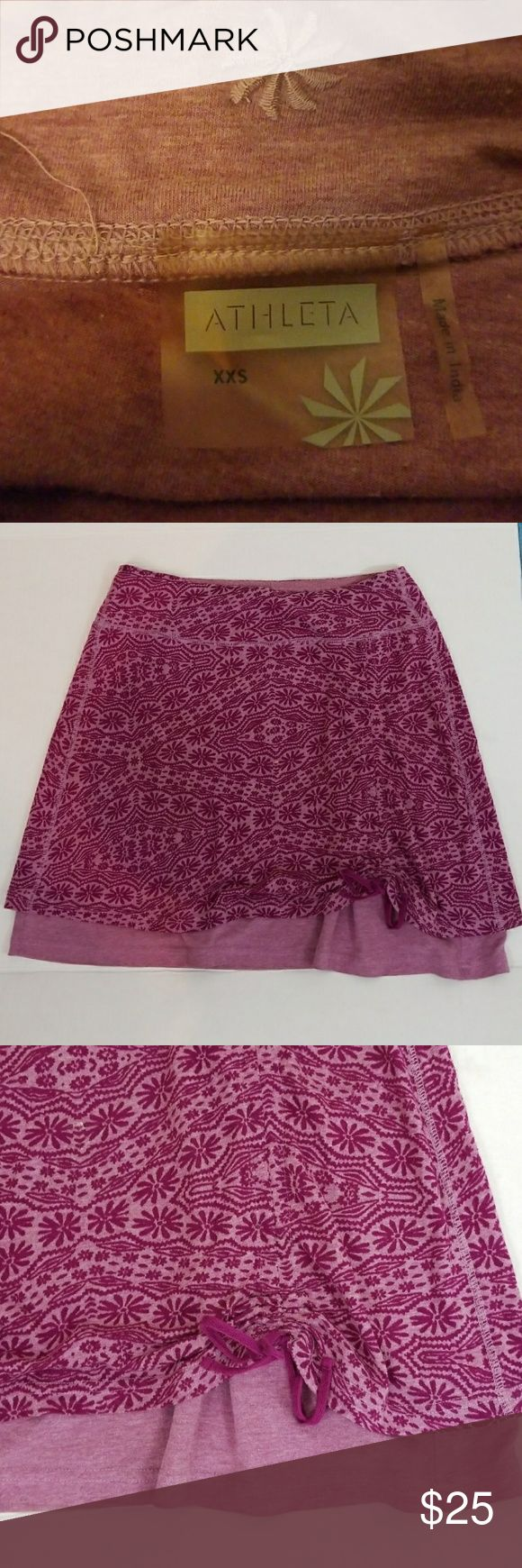 Athleta skirt xxs 💖💖💖deep pink and rose skirt. Extra soft cotton like a favorite t shirt.  2 layers, drawstring gather on the front right. Listed as xxs, however run large, please refer to the measurements above Athleta Skirts Mini