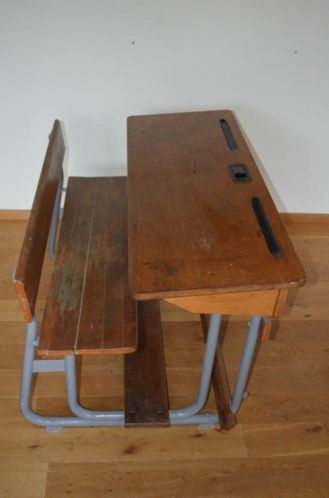 This is the kind of desk I had in Gr. 1 (and sat with a girl with bladder issues lol)