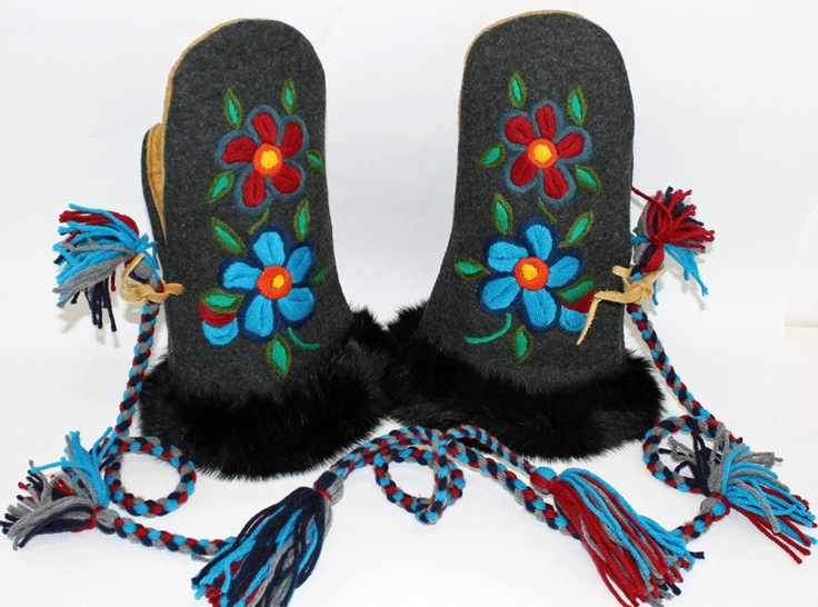 Details: Melton (or strout) mittens with rabbit fur trim braided wool/yarn tassels. Mittens have a floral embroidered design on the front. Made by: Dora Duncan, a Sahtu Dene of Colville Lake, NT residing in Alberta. $260