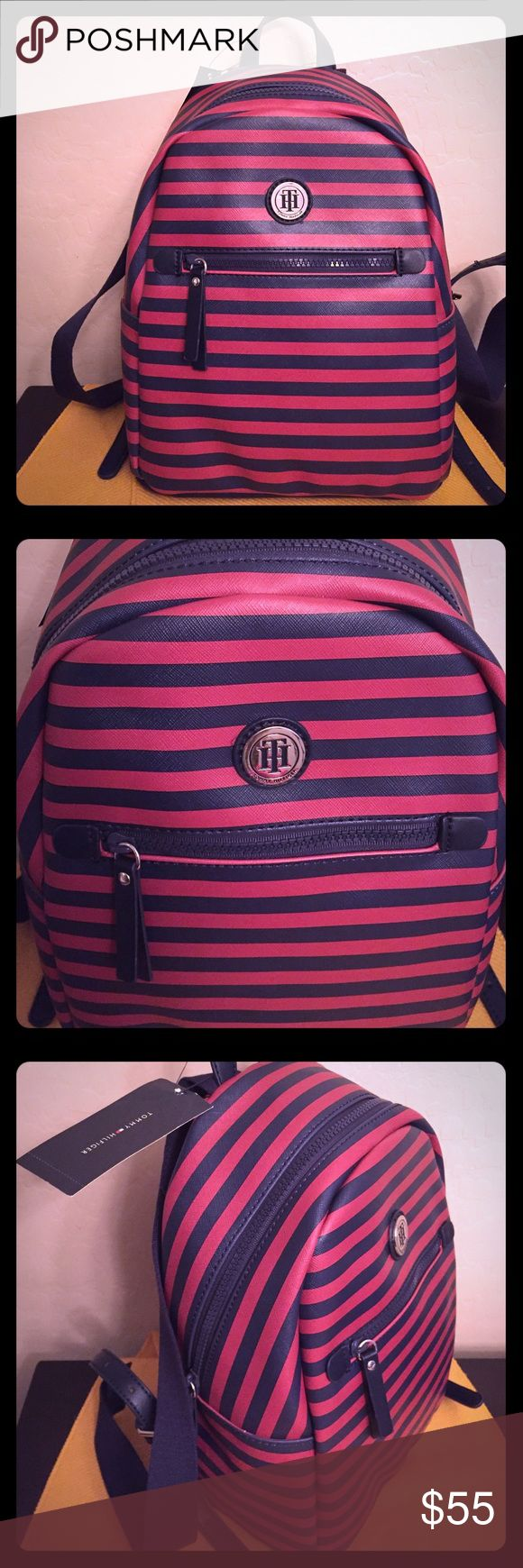 🆕 🎒Tommy Hilfiger Backpack🎒 🎒Authentic Tommy Hilfiger Backpack. Striped Red & Navy Blue with Navy Blue Accents. TH Silver Plate on the Front. Navy Blue Grab Bag & Straps. Adjustable Straps have Silver Buckles. 2 Zipped Compartments. The Larger One has 2 Storage Areas. One is Zipped. Lining is Navy Blue with Red. Brand New. Excellent Condition. No Trades. See Other Cool Backpacks in My Closet.🎒 Tommy Hilfiger Bags Backpacks