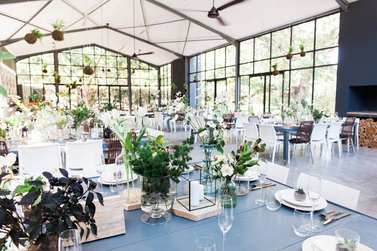 Metallics, greenery and hanging plants for this lovely couple. Photo by Dillon Kin