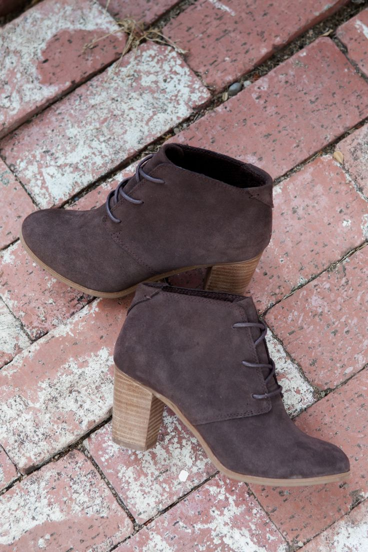 Lace up these chocolate suede Lunata Booties with a wooden stacked heel.