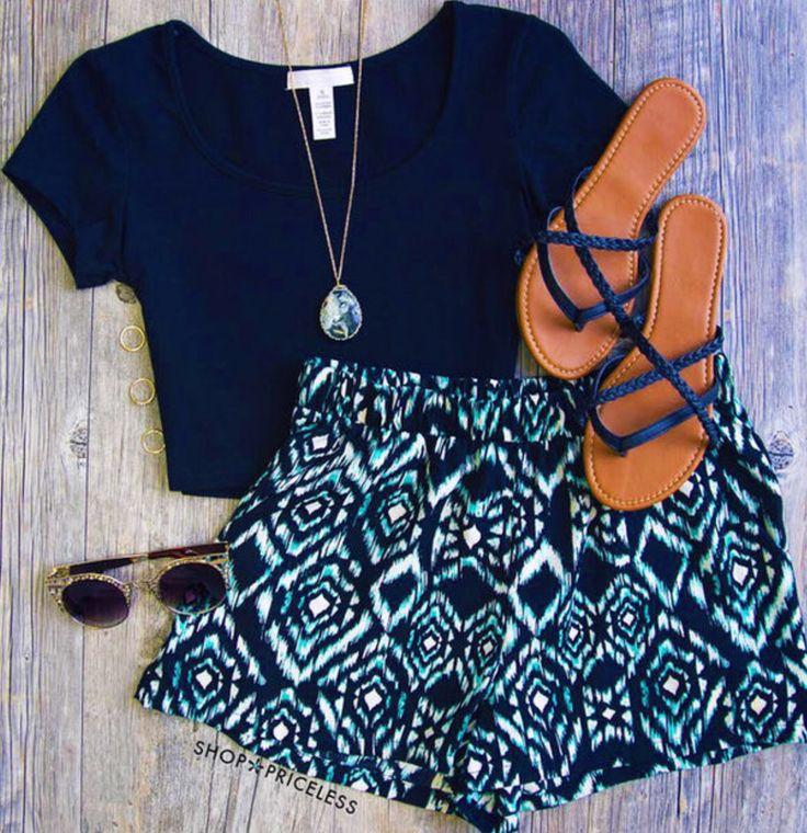 Turquoise, white & black printed shorts. Black crop top. Cute!