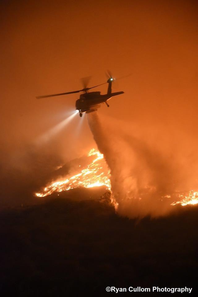A stunning photo by Ryan Cullom of an LA County Fire Firehawk working on a fire near Ventura 101 Fwy a few days ago.