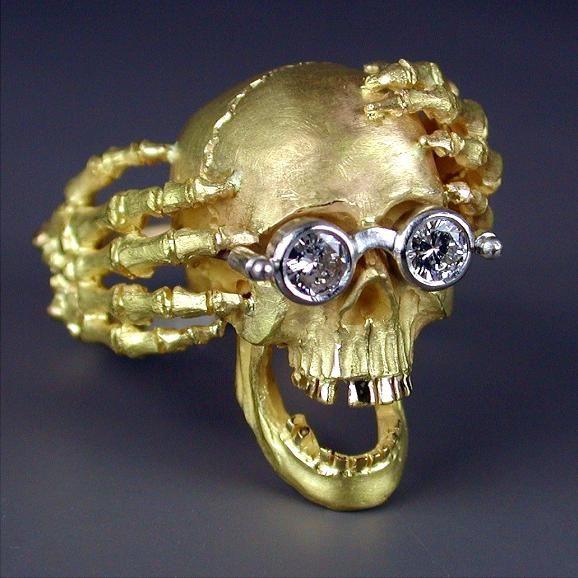 "Kim Eric Lilot   http://www.kimericlilot.com/ ""The Dreamer""  18kt yellow gold Skull ring  with Platinum glasses containing bezel set Diamond (0.25ct) lenses."