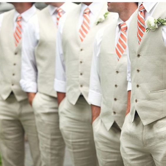 Groomsmen in khaki and coral. The perfect look for a summer wedding.