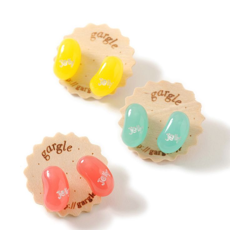 These **Jelly Bean Earrings** by **gargle** are available in three colors: **pink, mint,** and **yellow.** They are about **1.5 cm in size** and feature a **titanium post.** They look good enough to eat, but please don't! They come affixed to a **special gargle tag** that looks like a cookie making them a sweet, easy present for any candy lover. A matching necklace is also available for each color... #jfashion #kawaii