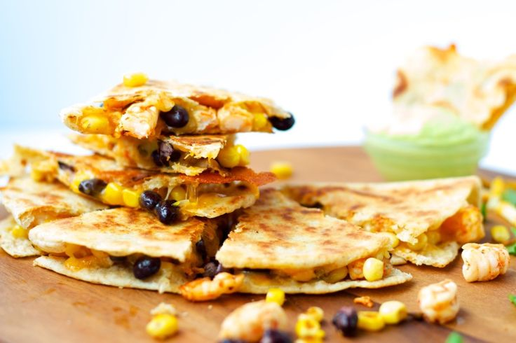 Shrimp Quesadillas with Avocado Cream - Shrimp quesadillas filled with corn, black beans and cheese, and an avocado cilantro lime cream dipping sauce. Quick, easy and amazing meal!