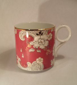 """Wedgewood Mug About: Wedgewood, """"Pink Rococo"""" From: Victoria's Basement, Sydney Price: $34 Quality: excellent Notes: I really wanted some Wedgewood, but with a tight budget I was unable to afford anything antique or any new tea cups, and while I do like Jasperware, it's not really my style. I was excited to find a mug that I really liked. I was wary about the handle style, but it's lovely to use, not inconvenient at all."""