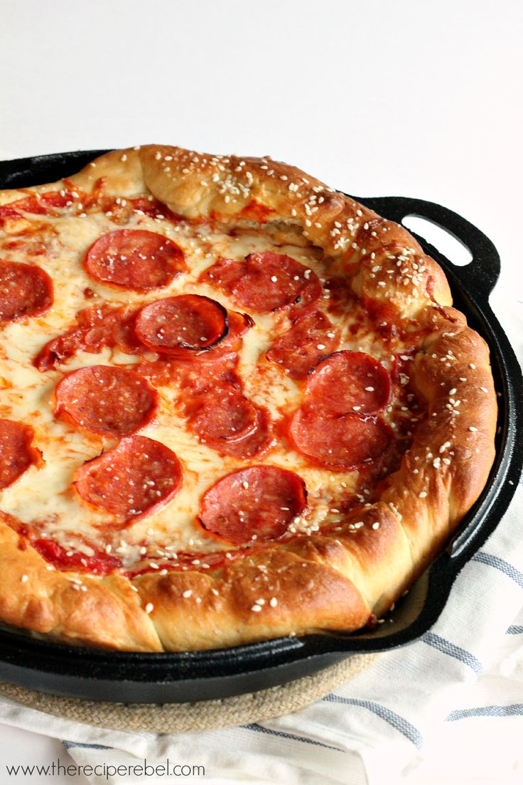 Deep-Dish Pretzel Crust Pizza -- the combination of the chewy, salty pretzel dough, sweet tomato sauce, spicy pepperoni and melty cheese is out of this world! You need to try this!