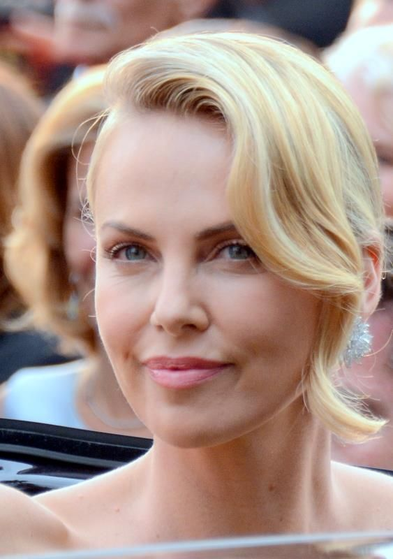 Theron promoting Mad Max: Fury Road at the 2015 Cannes Film Festival /Charlize Theron(1975-) a South African and American actress, producer, and fashion model. She has starred in several Hollywood films, such as The Devil's Advocate (1997), Mighty Joe Young (1998), The Cider House Rules (1999) and Mad Max: Fury Road (2015).