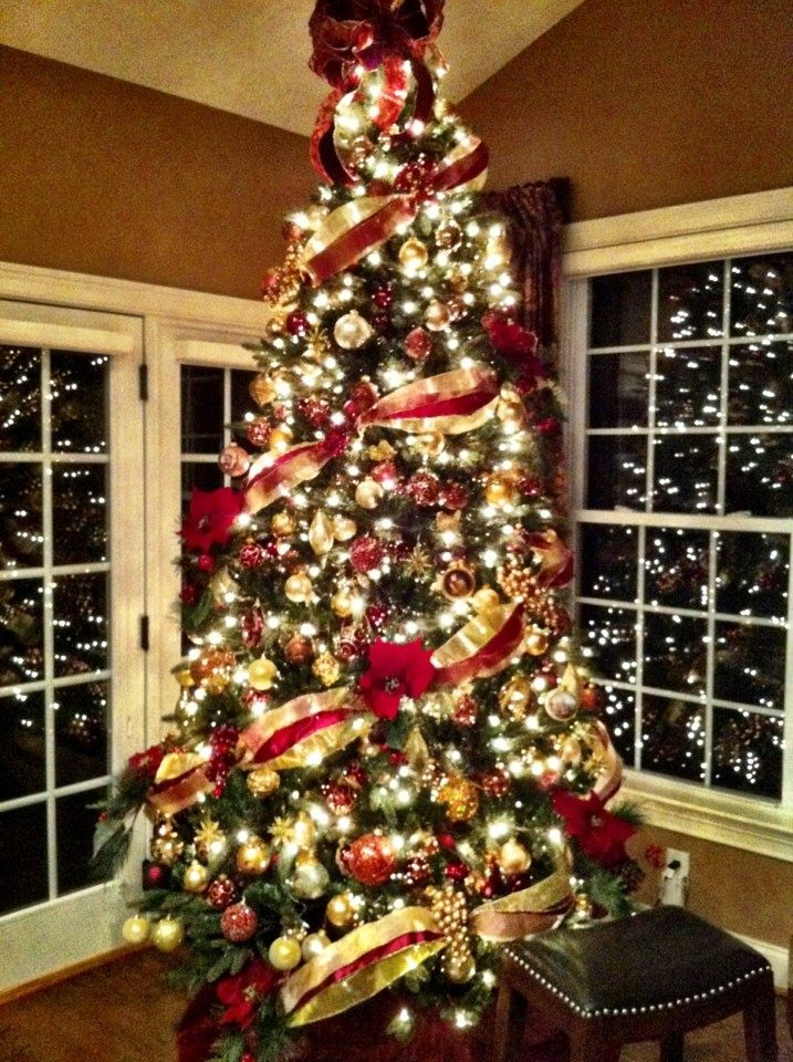 Top 10 Inventive Christmas Tree Themes Love The Bow On With Ribbon Going Around Red Gold