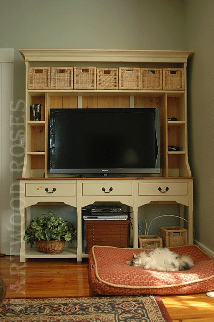 Dining hutch converted to hold a flat-screen TV.  Who says that TV furniture has to be ugly?