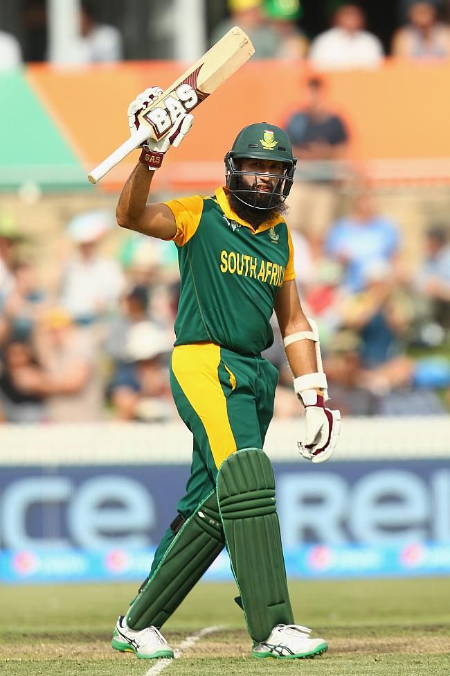 Hashim Amla of South Africa celebrates his century during the 2015 ICC Cricket World Cup match between South Africa and Ireland at Manuka Oval on March 3, 2015 in Canberra, Australia.