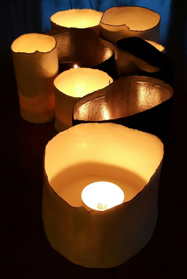 Candlelight induces quiet.Light several candles and listen to the volume go down.Porcelain lanterns,translucent when lit.