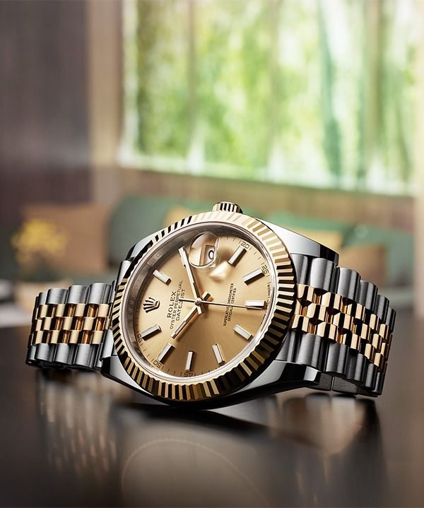 A classic and instantly recognisable Rolex Oyster Perpetual Datejust 41. Augmented with yellow Rolesor, champagne dial, and five-piece Jubilee bracelet.