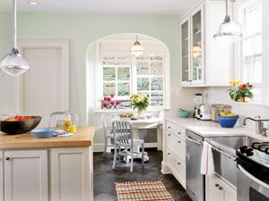 This kitchen has bright and cozy breakfast nook tucked away. #decorating