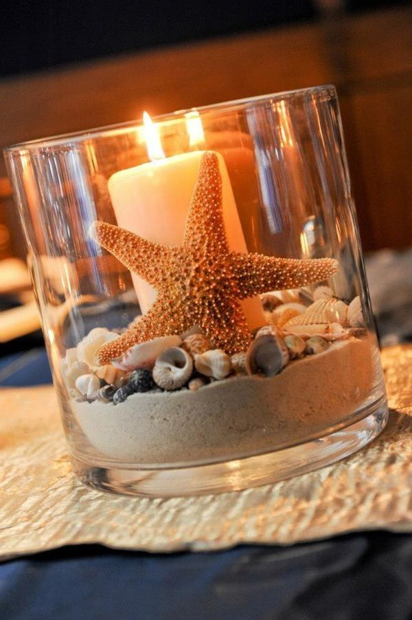 Befitting to a beach wedding, put some sand and sea shells in a glass jar and light it for that beautiful wedding by the beach.