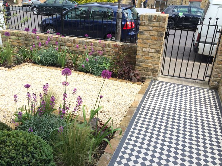 Small front garden design in London with victorian tile path