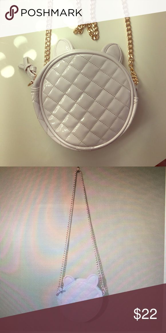 BRAND NEW ARIANA HRANDE PURSE Never used 💞 Brand new Ariana Grande purse with a rose gold chain and ears on Purse! Bags