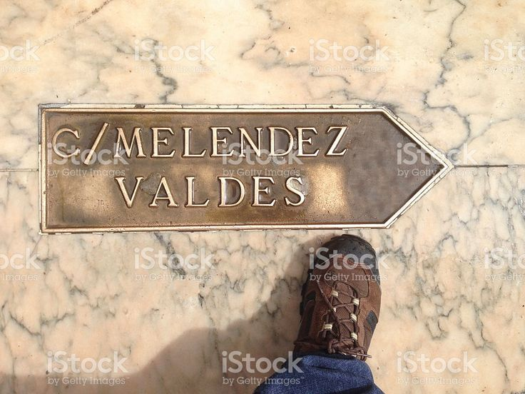 Traveller walking over street direction arrow at Badajoz Old Tow royalty-free stock photo