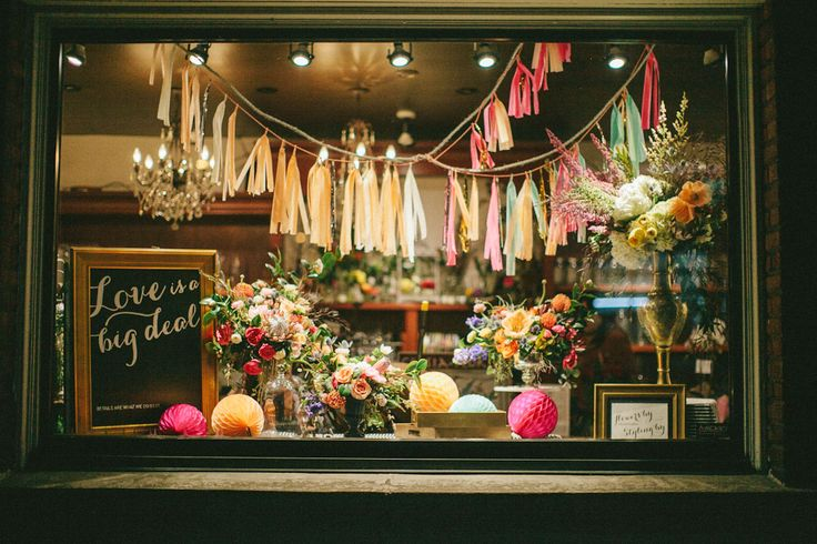 Celsia Florist window display. Styling by @Spread Love Events. Boho-chic-inspired florals repurposed from a photo shoot designed and styled by @Lé Soirées Weddings & Events.