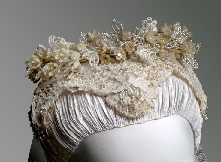 Grace Kelly's Wedding Headpiece (front detail) | United States, 1956 | Designed by Helen Rose (American 1904-1985). Made by the wardrobe department of Metro-Goldwyn-Mayer, Culver City, California, founded 1924 | Worn by Grace Kellyat her marriage to Prince Ranier of Monaco | Materials: silk needle lace (rose point), seed pearls, wax and paper orange blossoms, wire frame | Philadelphia Museum of Art