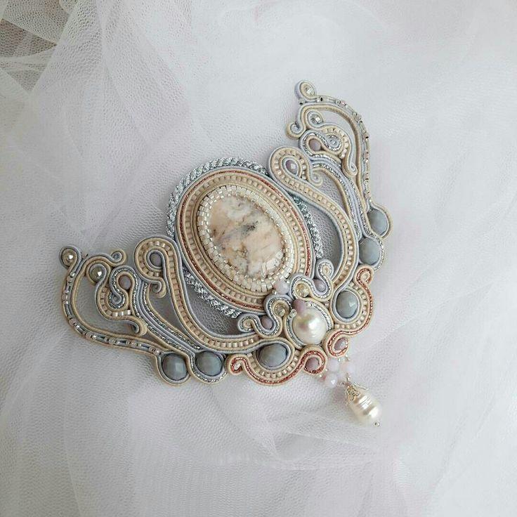 Gray, cream and copper brooch