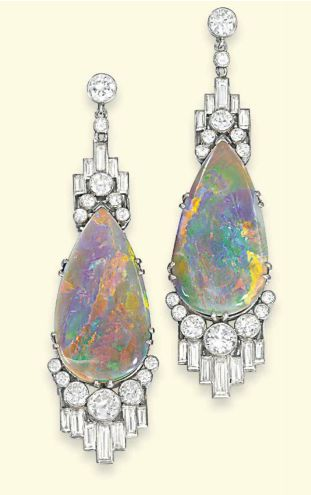 A PAIR OF ART DECO OPAL AND DIAMOND EAR PENDANTS. Each designed as a drop-shaped opal, the terminals decorated with staggered baguette-cut and circular-cut diamonds collets to the diamond surmount, circa 1930