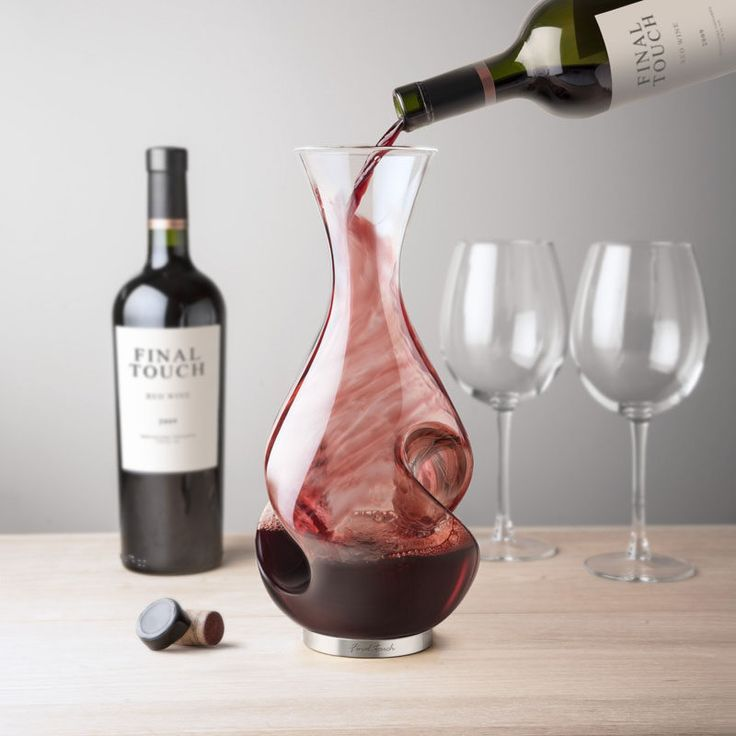 10 Unique Modern Wine Decanters // The curves on the sides of this decanter naturally swirl the wine around as it flows down the sides helping to aerate and oxygenate the wine.