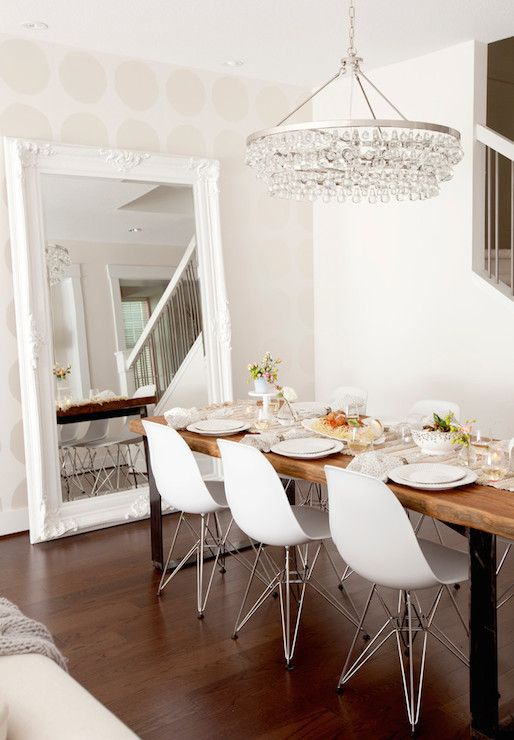 Stunning dining room with Moroccan table runner and lined with Eames Molded Plastic Chairs situated across from a leaning white baroque floor mirror. #dining