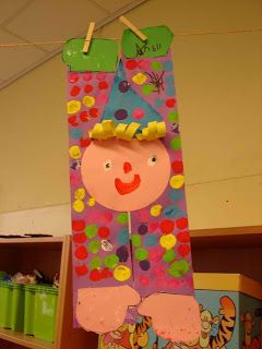 Maro's kindergarten: Cute Clown Craft! To make use to long piece of paper cut in rectangles for the body, make hands and shoes and a round face. Let students use a bingo dot marker to make polka dots {Page is in Greek and somethings get lost in translation}
