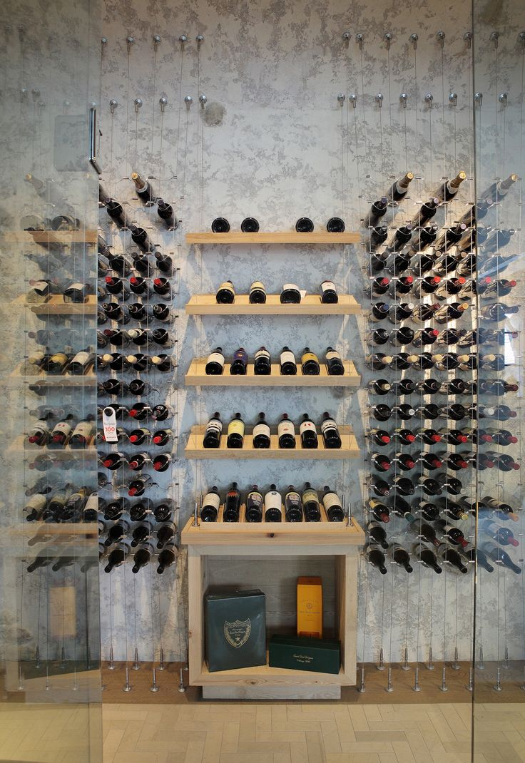 Contemporary custom wine cellar featuring the Cable Wine System.