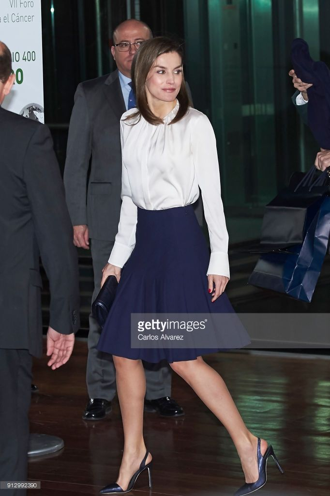 1 February 2018 - Queen Letizia attends 7th Against Cancer Forum in Madrid - blouse by Hugo Boss, shoes by Magrit, clutch by Felipe Varela