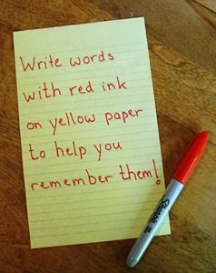 The theory is that writing with a red pen or marker on yellow paper helps you remember things.  There's an interesting article/study linked in this, as well.