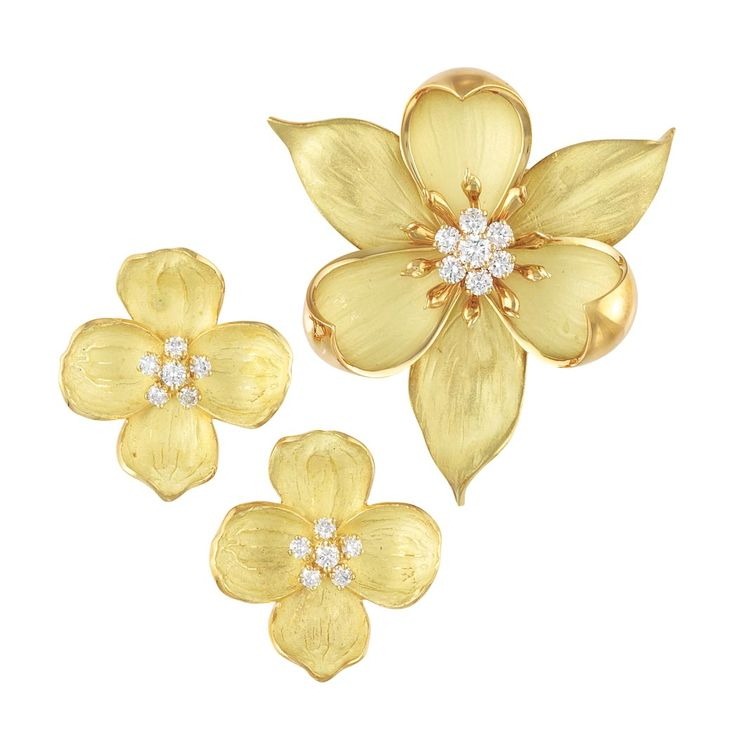Gold and Diamond Flower Brooch and Pair of Earrings, Tiffany & Co.  18 kt., the brooch and pair of earrings of similar design, composed of finely textured matte gold petals with polished gold edges, centering clusters of 19 round diamonds approximately 1.95 cts., signed Tiffany & Co., approximately 27.3 dwts.