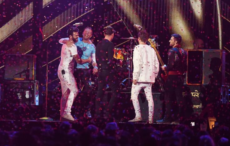 """The Chainsmokers and Coldplay performed their latest song """"Something Just Like This"""" at the 2017 Brit Awards and premiered the lyric video on VEVO."""